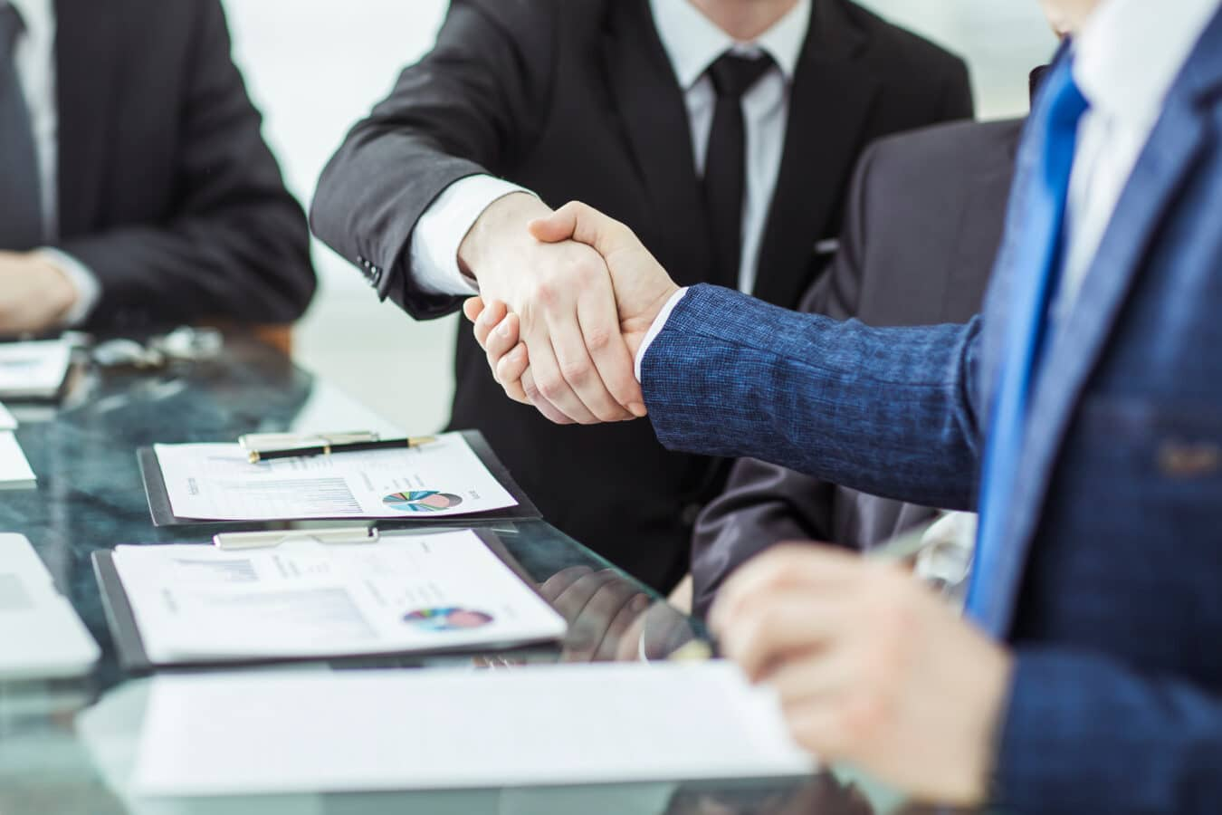 Investor and business owner shaking hands over the confirmation of crisis loan