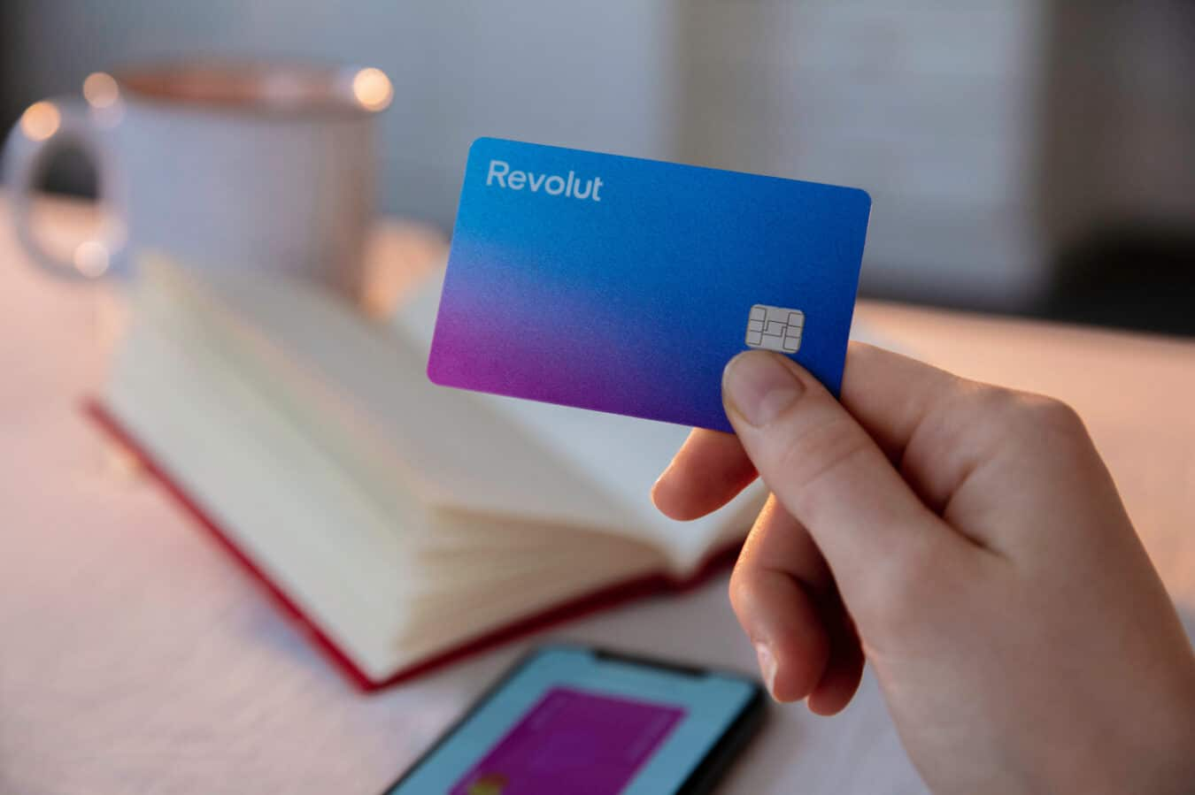 revolut card in a persons hand