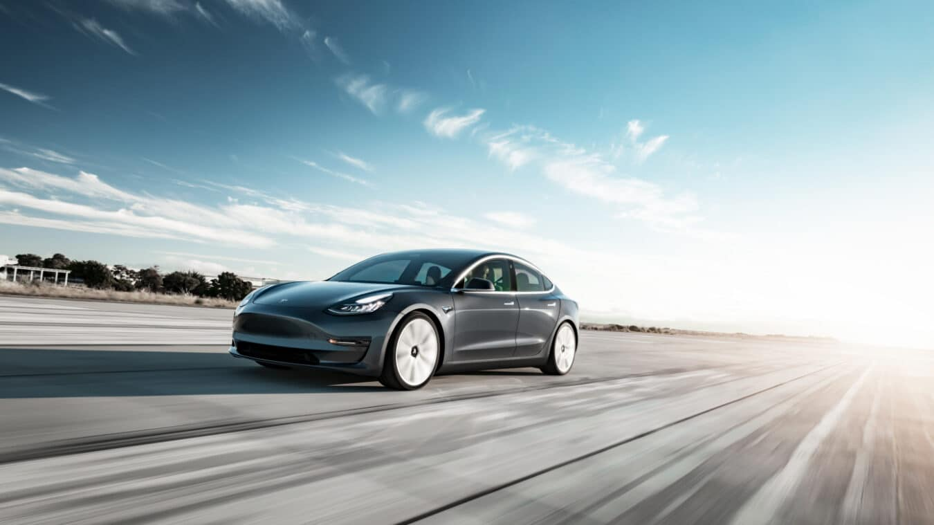 tesla model 3 silver tarmac in movement